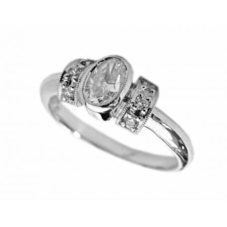 Złoty pierścionek z owalną cyrkonią ,biały